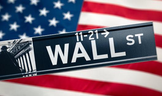 Американские фондовые индексы завершили торги почти без изменений