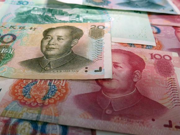 Юань укрепился к доллару на фоне решения ФРС США