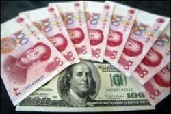 Юань вырос к доллару до максимума за 17 лет после повышения ставок ЦБ КНР