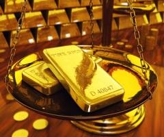 Золото колеблется возле отметки 1300 $