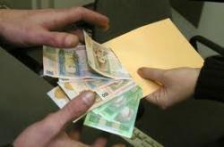 Кабмин возьмется за масштабную легализацию зарплат «в конвертах»