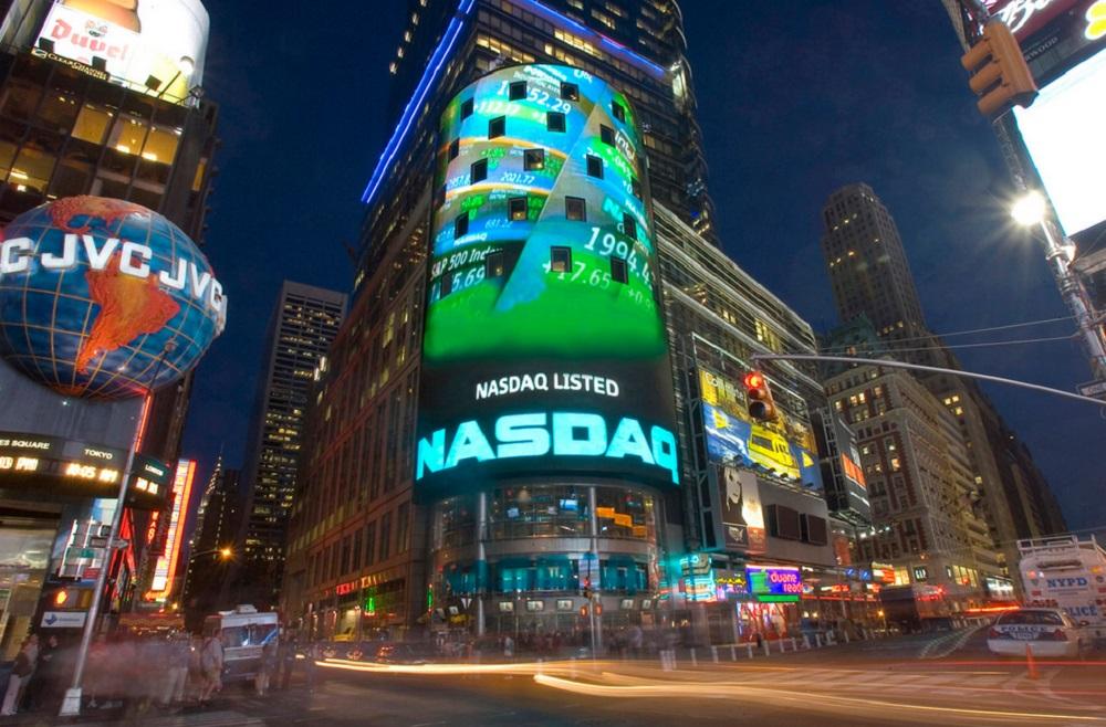 Американские акции завершили летучие торги со скромными положительными результатами