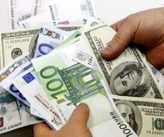 ЦБ повысил официальные курсы доллара и евро
